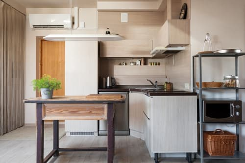 Where should a refrigerator be placed in a kitchen